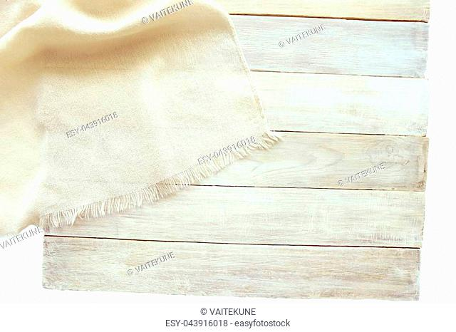 Shawl fabric on aged white wooden planks