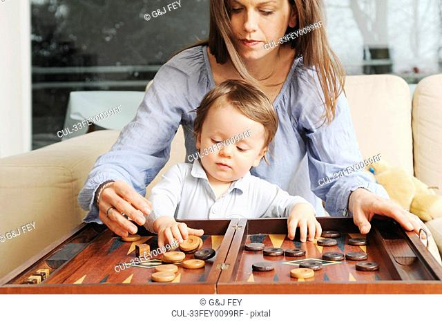 Mother and son playing backgammon
