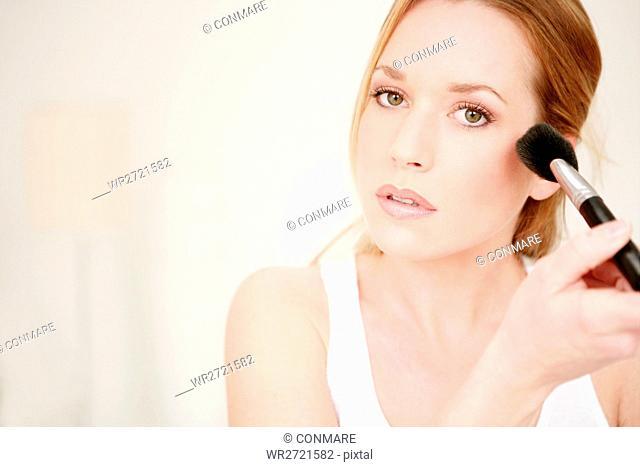 young, woman, applying, powder, brush, cheek, beau
