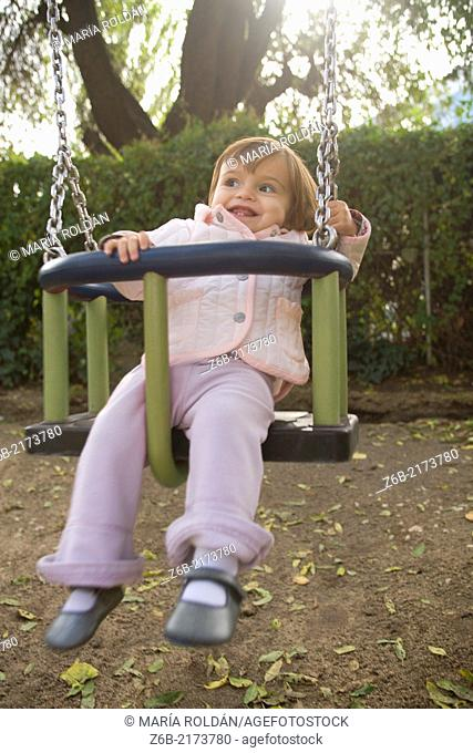 babygirl, One year, Toddler, Outdoors, Garden, Playground, Swing, Almond Tree, Autumn, Toothless, tooth