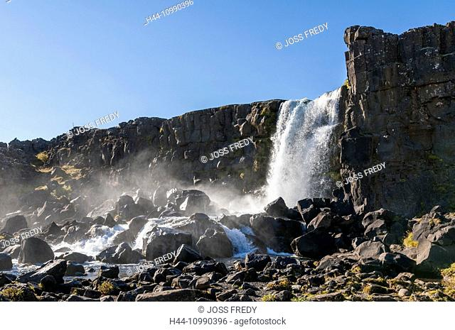 Almannagja gorge in Pingvellir national park with Öxararfoss waterfall, southwest Iceland