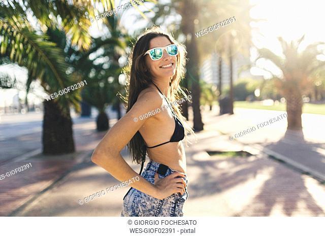 Portrait of young woman, waering beach wear