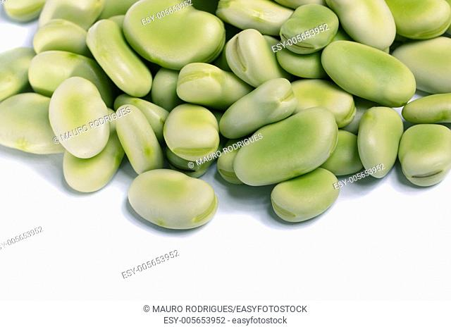 Close up view of some broad beans isolated on a white background