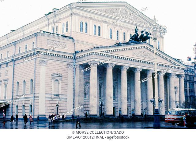 View facing northeast of visitors walking outside of the Bolshoi Theater, in Moscow, Soviet Russia, USSR, November, 1973