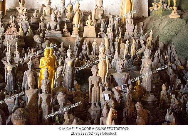 Hundreds of Buddha statues have been brought to the Pak Ou Caves on the Mekong River in Laos