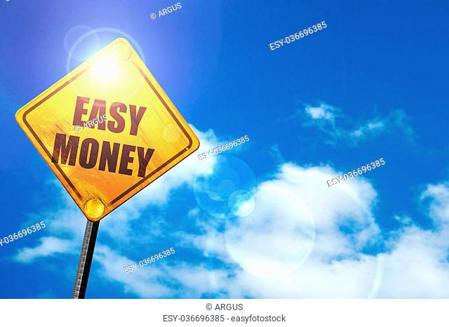 easy money: yellow road sign with a blue sky and white clouds