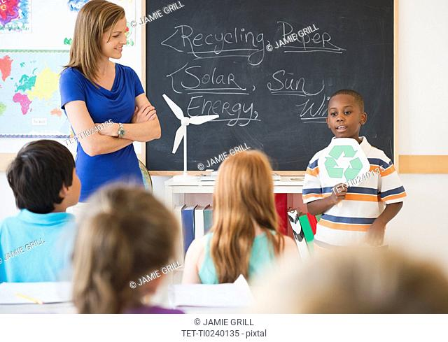 School children 8-9 with female teacher during class