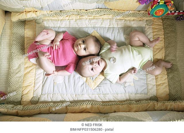 High angle view of two babies on blanket