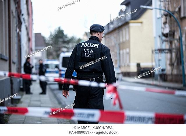 A police officer standing in cordoned off Sedanstrasse (Sedan Street) in Herne, Germany, 10 March 2017. Marcel H., the alleged murderer of a 9-year-old boy...
