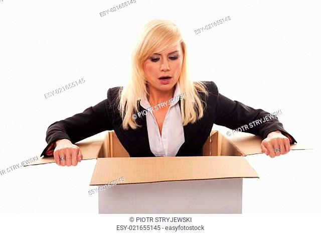 Scared young blonde getting out from a box