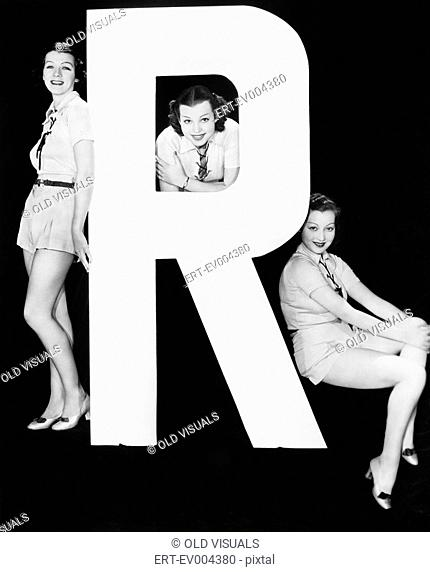 Three women posing with huge letter R All persons depicted are not longer living and no estate exists Supplier warranties that there will be no model release...