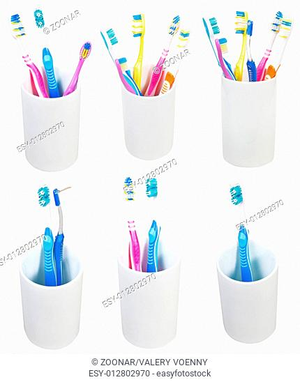 collection of toothbrushes in ceramic glases