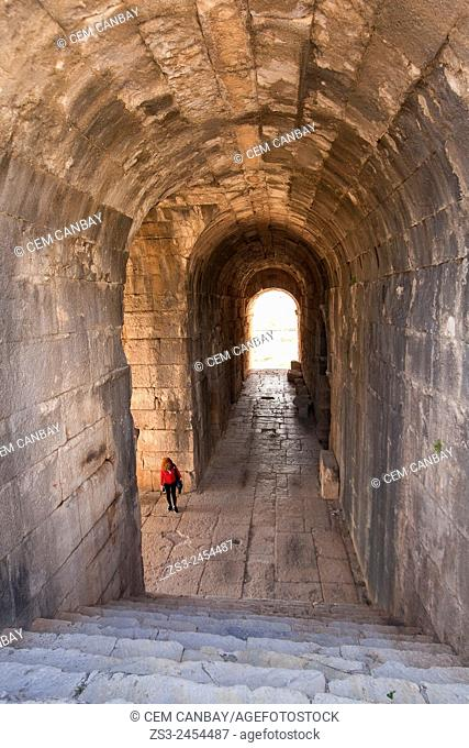 Tourist inside the ruins on a passageway leading to the ancient amphitheater of Miletus, Milet, Aydin Province, Turkey, Europe