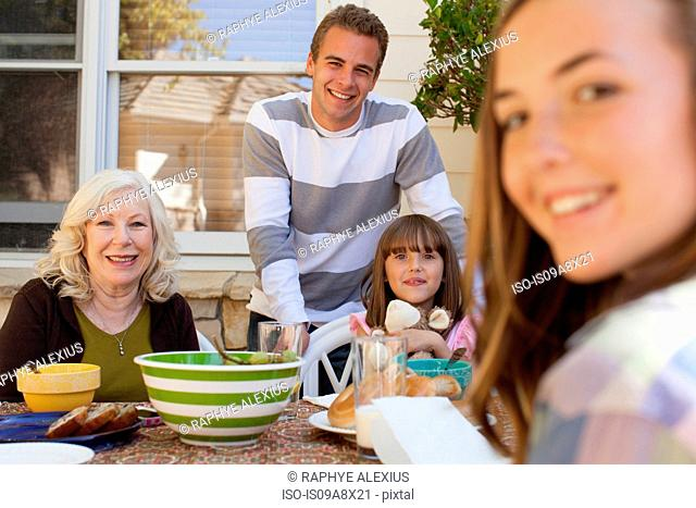 Family having breakfast outdoors