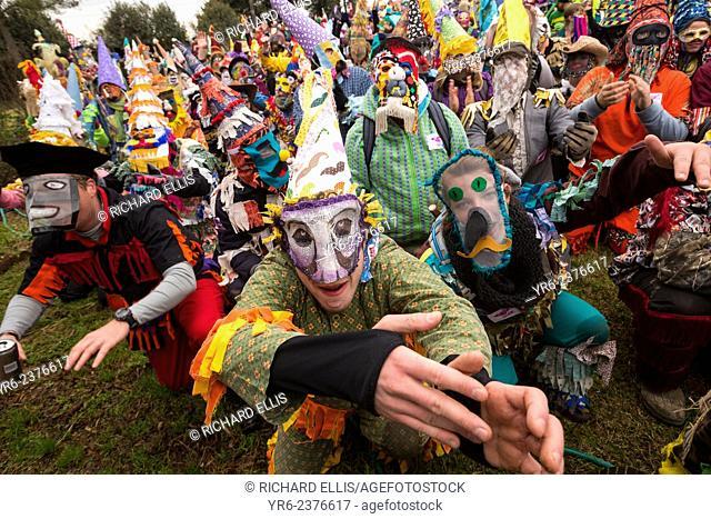 Revelers beg a family for food donations during the Faquetigue Courir de Mardi Gras chicken run on Fat Tuesday February 17, 2015 in Eunice, Louisiana