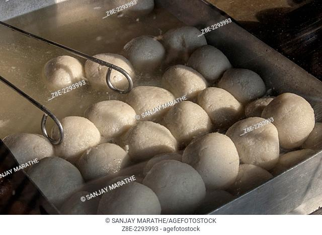 'Roshogollas' a popular bengal sweet at a shop in Kolkata (Calcutta), West Bengal, India. The sweets of Bengal, called 'mishti' in the local language