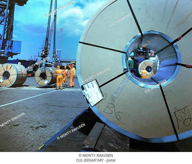 Rolls of steel being loaded in port, Grimsby, England, United Kingdom