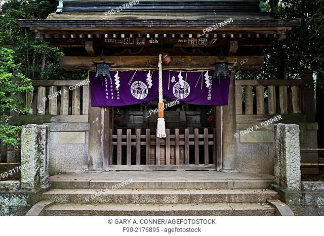 Chapel cloth and summoning bell at Nezu Shrine in Tokyo, Japan