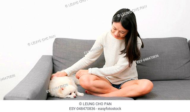 Woman touching on her dog at home