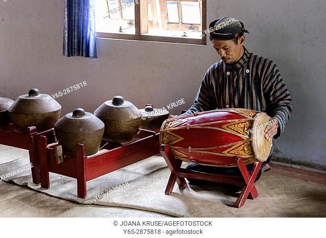 man playing traditional gamelan drums in Magelang, Borobudur, Java, Indonesia, Asia