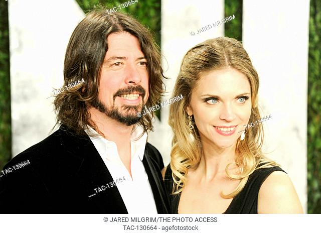 Dave Grohl and Jordyn Blum Grohl arrive for the 2013 Vanity Fair Oscar Party hosted by Graydon Carter at Sunset Tower on February 24, 2013 in West Hollywood