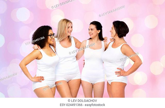friendship, beauty, body positive and people concept - group of happy women different in white underwear over rose quartz and serenity lights background