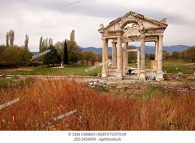Tourist at the antique Tetrapylon in the ancient ruins of Aphrodisias, Aydin Province, Aegean Coast, Turkey, Europe