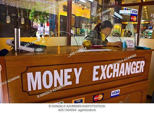 Money exchanger. Ho Chi Minh City (formerly Saigon). South Vietnam