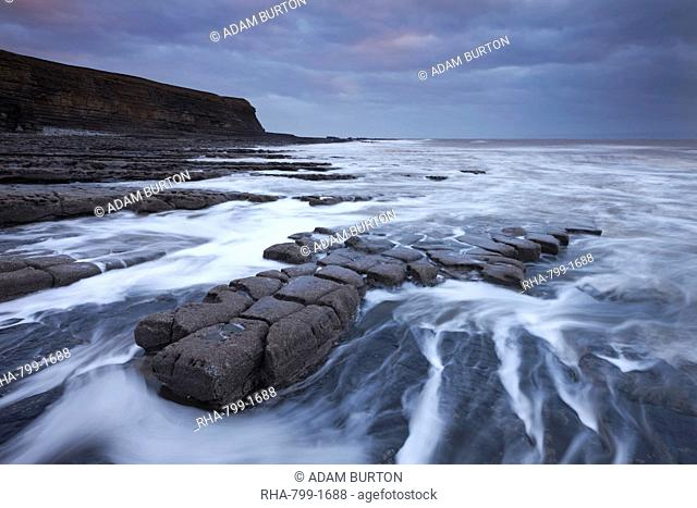 Waves rushing around broken ledges at Nash Point on the Glamorgan Heritage Coast, Wales, United Kingdom, Europe