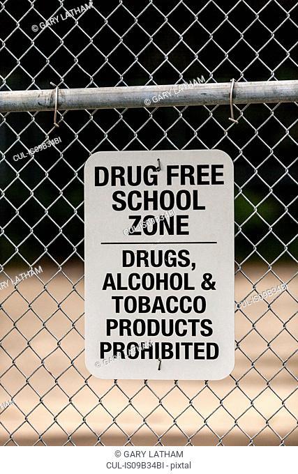 Warning sign on school wire fence, Seldovia, Kachemak Bay, Alaska, USA