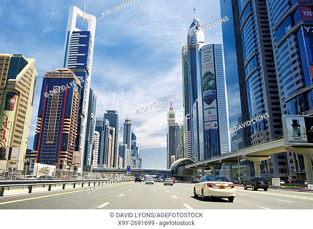 Sheikh Zayed Road in city of Dubai. From left Chelsea Tower, Al Yaquob Tower and Rose Tower. Also Financial Centre Metro Station