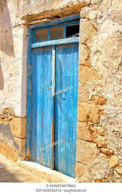 Door of an old building in Hersonissos, Crete, Greece