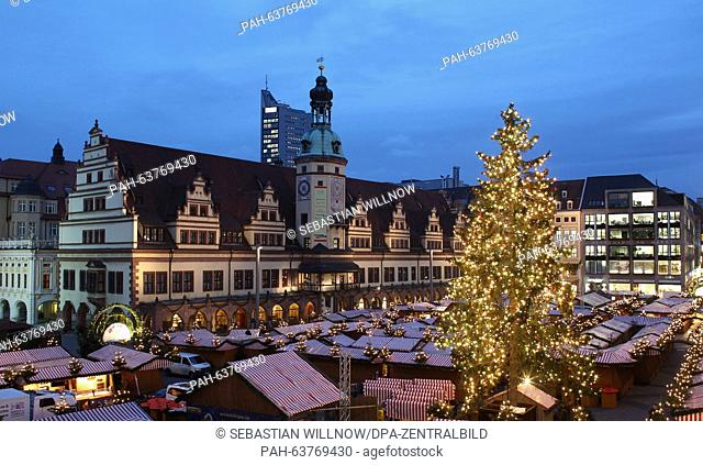 The Christmas tree lights at the Christmas market in front of the old town hall in Leipzig, Germany, 19 November 2015. Around 3