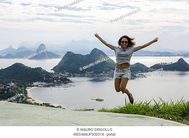 Brazil, woman on a viewpoint in Rio de Janeiro