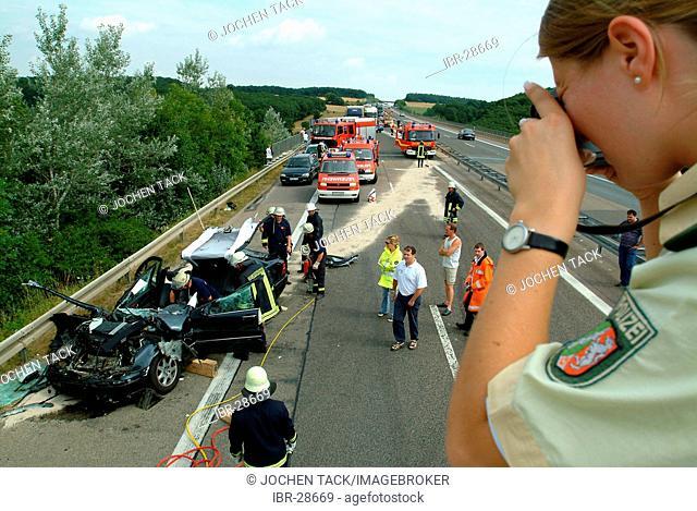 DEU, Germany, NRW: Heavy accident on the Autobahn, motorway A1, near Bad Muenstereifel. A Mercedes Benz car crashed with a app