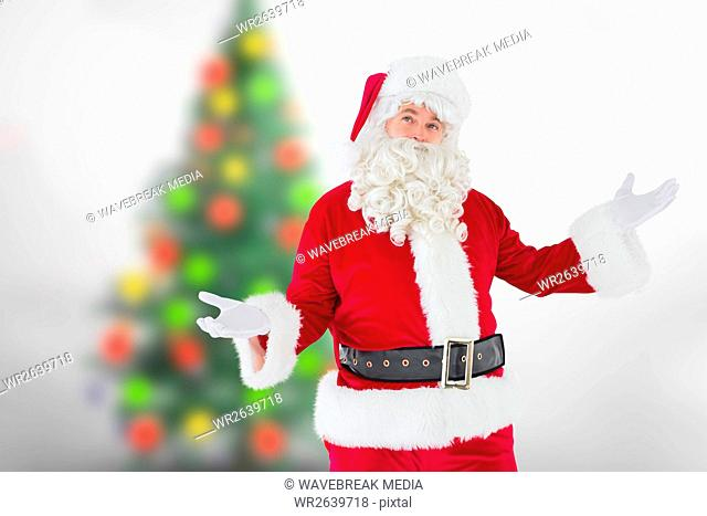 Santa claus gesturing against blur background