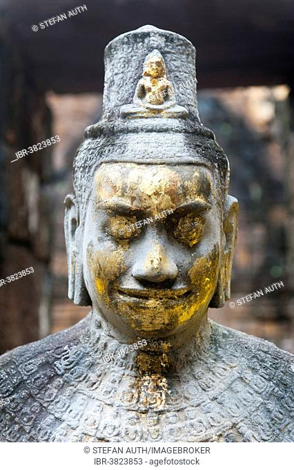 Buddhist statue of Bodhisattva Avalokiteshvara with offerings in the temple, historical settlement of the Khmer, Mueang Sing Historical Park, Amphoe Sai Yok