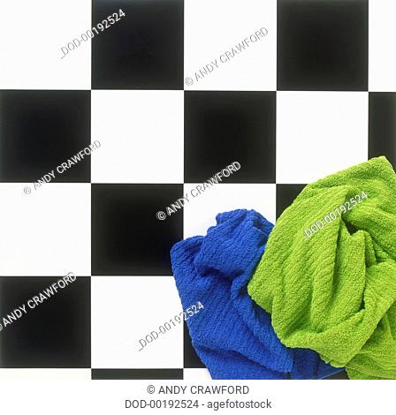 Towels on black and white bathroom floor, view from above