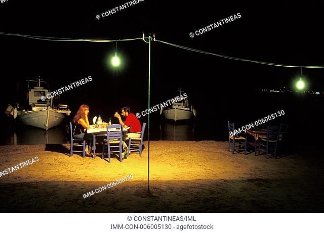 Port, couple sitting alone near sea  Greece: Peloponnese: Elafonissos