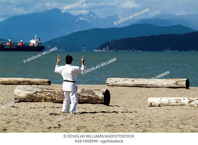 a man practices martial art at Locarno Beach in Vancouver, BC, Canada
