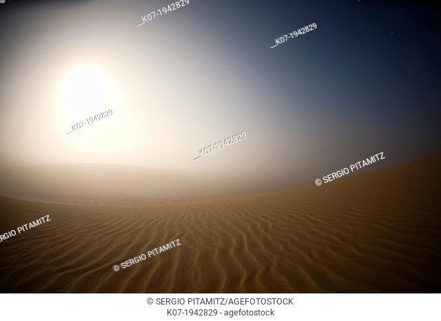 Moonrise in the mist over Sand Dunes, Skeleton Coast National Park, Namibia