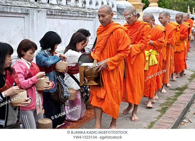 Monks receiving alms, Luang Prabang, Laos