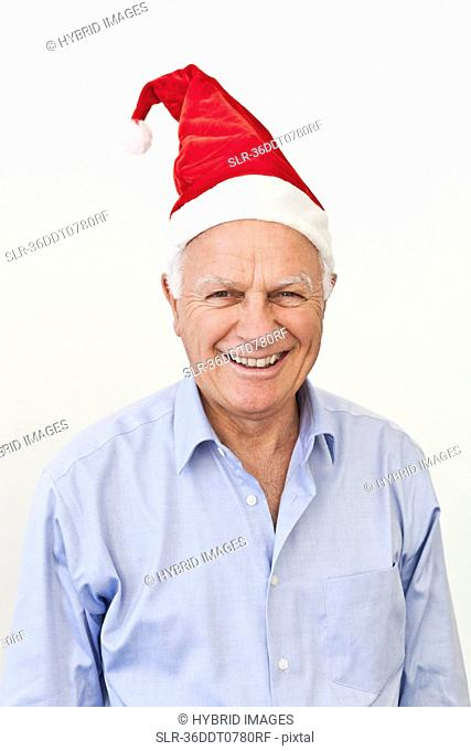 Smiling businessman wearing Santa hat