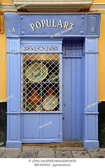 A blue shop front in downtown Sevilla, Andalusia, Spain, Europe