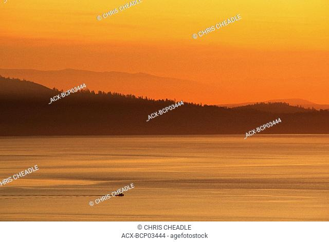Fishing Troller on the Haro Strait with layered hills beyond, Victoria, Vancouver Island, British Columbia, Canada