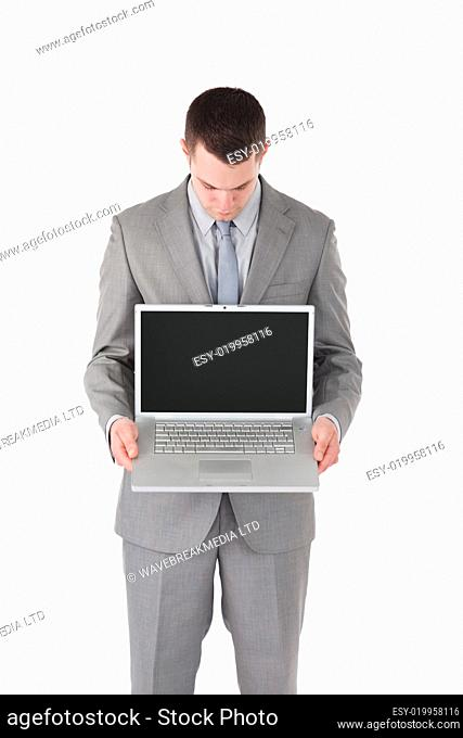 Portrait of a businessman looking at a laptop&#039 s screen