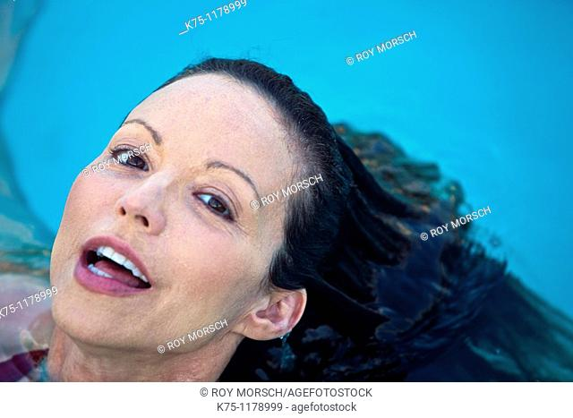 Woman surfacing from water close up