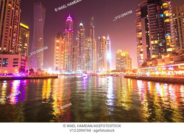 Night view of skyline with apartment building skyscrapers at Dubai Marina district in Dubai, UAE