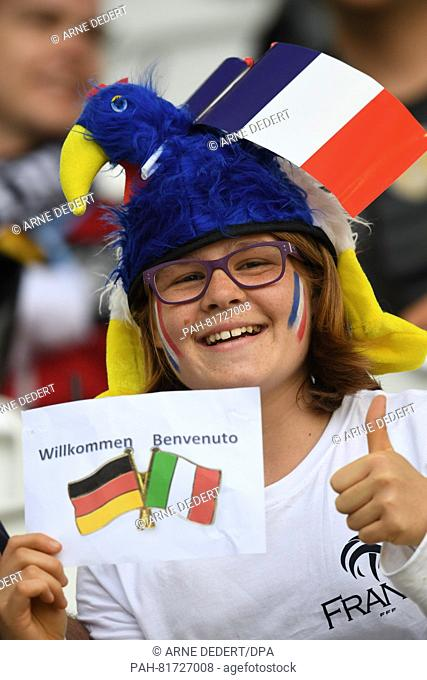 "A young supporter holds a """"welcome"""" sign sign prior to the UEFA EURO 2016 quarter final soccer match between Germany and Italy at the Stade de Bordeaux in..."