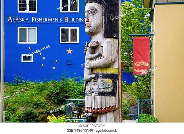 Totem pole in front of museums, Alaska Fishermen's Building, Juneau-Douglas City Museum, Juneau, Alaska, USA